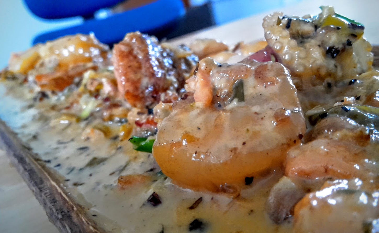 Prawns, crispy skin salmon, baby octopus, is creamy garlic herb sauce – Ash Simmonds